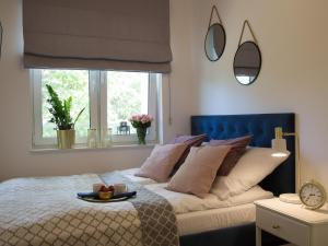Łóżko lub łóżka w pokoju w obiekcie Apartament 59 Dwie Sosny