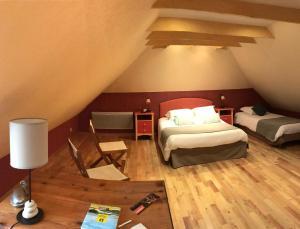 Un ou plusieurs lits dans un hébergement de l'établissement Hotel Spa Le Relais Des Moines