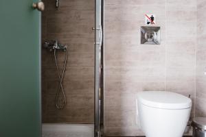 A bathroom at Piraeus Port Hotel