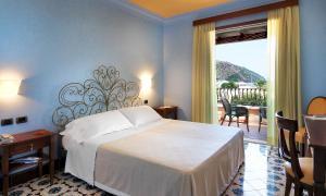 Letto o letti in una camera di Hotel Aktea