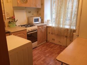 Кухня или мини-кухня в 1-room Apartment near Kristal