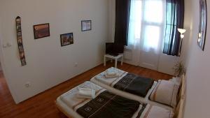Postel nebo postele na pokoji v ubytování Jezerka Apartments