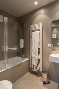 A bathroom at Four Stars Aparthotel