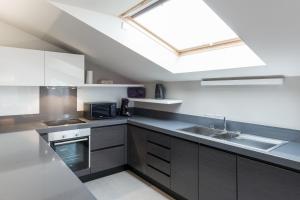 A kitchen or kitchenette at Four Stars Aparthotel