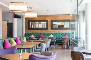 A restaurant or other place to eat at Hilton Garden Inn Glasgow City Centre