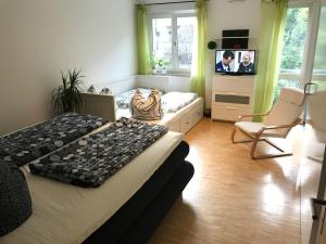 A bed or beds in a room at City Wohnung Halle am Markt