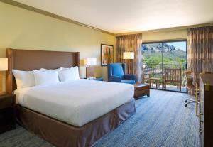 A bed or beds in a room at El Conquistador Tucson, A Hilton Resort