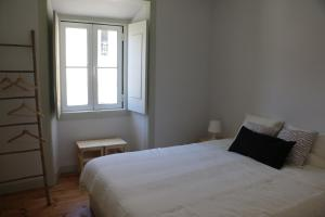 A bed or beds in a room at Casa do Termal