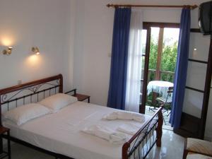 Ένα ή περισσότερα κρεβάτια σε δωμάτιο στο Hotel Tsagarada