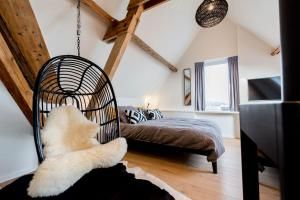 A bed or beds in a room at Loods Logement