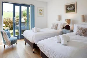 A bed or beds in a room at The Park at Mawgan Porth