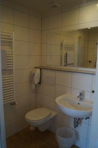 Ванная комната в Hotel Garni Wilder Mann