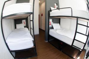 A bunk bed or bunk beds in a room at 91 Loop Boutique Hostel