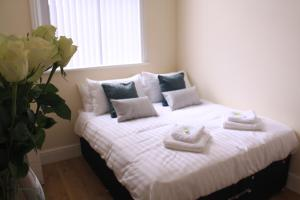 A bed or beds in a room at The Manchester