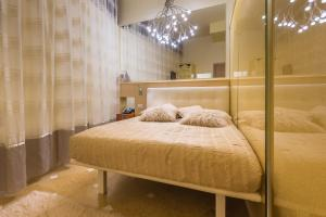 A bed or beds in a room at Ca' Dei Dogi