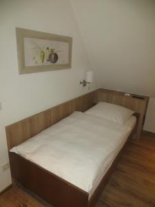 Ein Bett oder Betten in einem Zimmer der Unterkunft Gasthof Weißes Lamm
