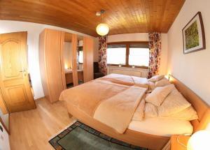 Ein Bett oder Betten in einem Zimmer der Unterkunft Panoramablick