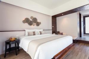 A bed or beds in a room at Sarikantang Resort & Spa, Koh Phangan - SHA Plus