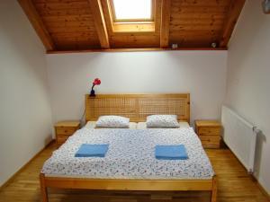 Кровать или кровати в номере Pension Charlie