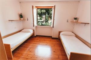 Letto o letti in una camera di Domus Leonardo-Private Free Parking