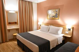 Ένα ή περισσότερα κρεβάτια σε δωμάτιο στο Onar Pension