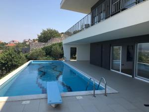 The swimming pool at or near Modern Swimming-Pool Villa