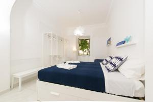 A bed or beds in a room at Ottaviano Exclusive Maison