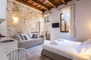 Ένα ή περισσότερα κρεβάτια σε δωμάτιο στο Casa Dei Delfini