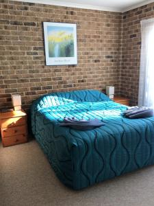A bed or beds in a room at Beachfront Apartments