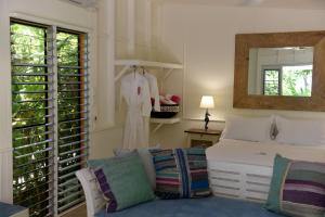 A bed or beds in a room at Sejala Beach Huts
