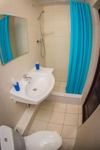 Ванная комната в Aura Hotel-ZURO