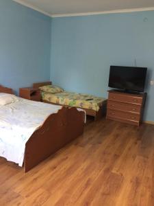 Кровать или кровати в номере Гостевой дом Софа