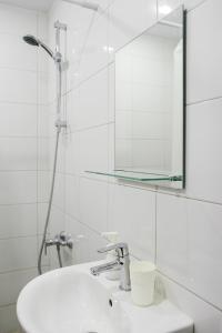 Ванная комната в Ruzoff Apart by Solaren