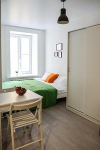Кровать или кровати в номере Ruzoff Apart by Solaren