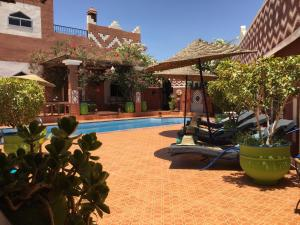 The swimming pool at or near Le Petit Riad Maison d'hôtes