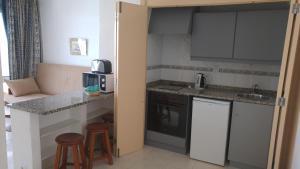 Een keuken of kitchenette bij Edificio Albufeira Apartamentos A. Local - Albuturismo Lda