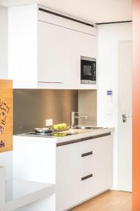 A kitchen or kitchenette at Capri by Fraser Berlin