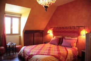 Un ou plusieurs lits dans un hébergement de l'établissement Chambres d'hôtes Les Charmettes