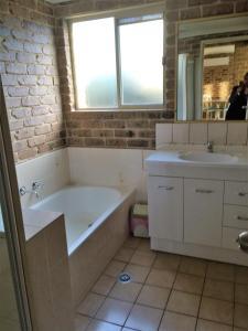 A bathroom at Beachfront Apartments