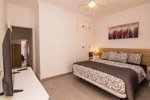 A bed or beds in a room at Villa Sontrobat
