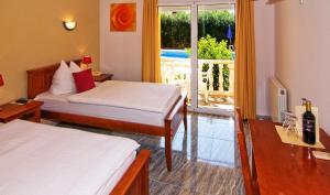 Cama o camas de una habitación en Hotel Montemar