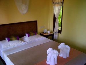Ein Bett oder Betten in einem Zimmer der Unterkunft Paradise Bungalows