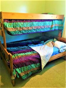 A bed or beds in a room at Gold Coast Family Cottages
