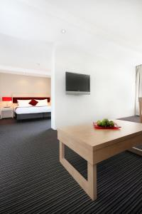 A television and/or entertainment center at Central Studio Hotel Sydney