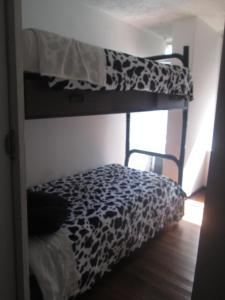 A bunk bed or bunk beds in a room at Hostal Donde Lili