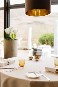 Een restaurant of ander eetgelegenheid bij Wein- & Tafelhaus