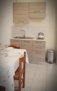 Cucina o angolo cottura di Happy Apartment Lecce