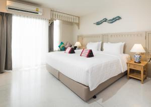 Letto o letti in una camera di Panphuree Residence SHA