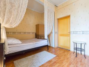 Кровать или кровати в номере Dorogomilovskya 11