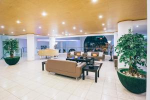 The lobby or reception area at Grand Muthu Forte do Vale